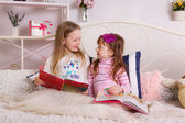 Childrens on the bed with books — Stock Photo