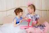 Beautiful girls open presents — Stock Photo