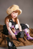 Little girl wearing big mothers shoes — Stock Photo