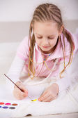 Girl drawing with paints — Stock Photo