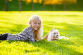 Girl with a dog breed lap dog in the park — Stock Photo