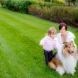 Happy family with the dog — Stock Photo