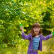 girl  jumping with a rope in the garden — Stock Photo