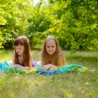 Girls lying  on the nature — Stock Photo
