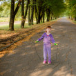 Girl jumping on a skipping rope — Stock Photo