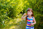 Happy girl with soap bubbles — Stock Photo