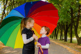 Beautiful girls under an umbrella — Stock Photo
