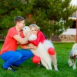 Young married couple trained dogs — Stock Photo