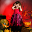 Little girl in a  witch costume on Halloween — Stock Photo