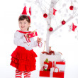 Baby girl  near Christmas tree with presents — Stock Photo