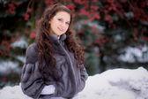 Girl in a fur coat in winter — Foto de Stock
