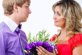 Couple with a bouquet of flowers — Stock Photo