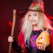 Girl  with pumpkins and broom on Halloween — Foto Stock