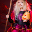 Girl  with pumpkins and broom on Halloween — Stock Photo