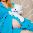 Pregnant woman  with teddy bear — Stock Photo