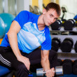 Man with dumbbells in a gym — Stock Photo
