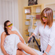 Laser hair removal on the legs — Stock Photo