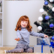 Little girl opens a gift — Stock Photo #32285489