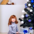 Little girl opens a gift — Stock Photo #32285491