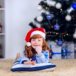 Girl with little gift under the Christmas tree — Stock Photo