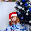 Child in pajamas near the Christmas tree — Stock Photo #32285529