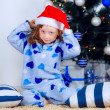 Child in pajamas near the Christmas tree — Stock Photo #32285543