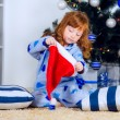 Child in pajamas near the Christmas tree — Stock Photo #32285549