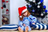 Child in pajamas near the Christmas tree — Stock Photo