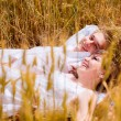 Couple lying in the wheat field — Stock Photo