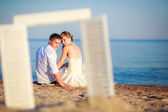 Newlyweds looking through the window frame — Foto Stock
