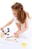 Girl drawing on paper with paint — Stock Photo