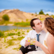 Couple kissing and  drinking champagne — Stock Photo
