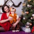 Mother and son near Christmas tree — Stock Photo #33596179