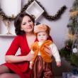 Mother and son near Christmas tree — Stock Photo