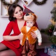 Mother and son near Christmas tree — Stock Photo #33596229