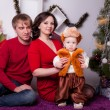 Family near the Christmas tree — Stock Photo