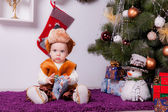 A little boy in the wolf costume with gifts — Stock Photo