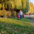 Girl with little brother playing in the park — Stock Photo