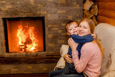 Brother and sister hugging near the fireplace — Foto Stock