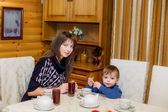 Mother and son drinking tea — Stock Photo