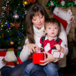 Mother and son opening christmas gifts — Stock Photo
