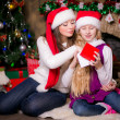 Mom and daughter open gifts — Stock Photo