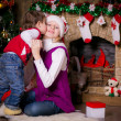 Brother and sister hugging near a Christmas tree — Stock Photo