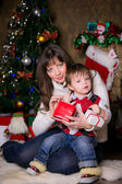 Mother and son opening Christmas presents. — 图库照片