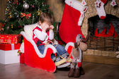 Boy crying near a Christmas tree on a sled — Foto Stock