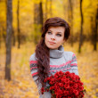 Girl with a bouquet in autumn forest — Stock Photo