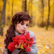 Girl with berries in the hands of  in the autumn forest — Stock Photo