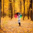 Girl in the forest with umbrella — Stock Photo