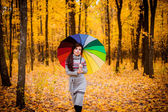Girl in the forest walking with umbrella — Stock Photo