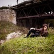 Girl lying in the grass near the bridge — Stock Photo #34594855